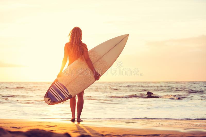 surfer-girl-beach-sunset-beautiful-sexy-39876476